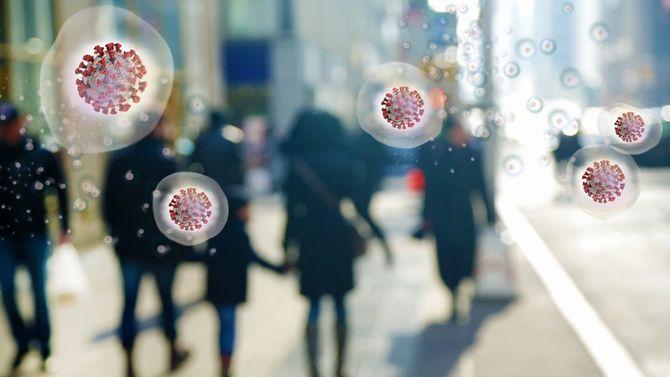 新型コロナのコンセプト画像。人々の周りに漂うウイルス
