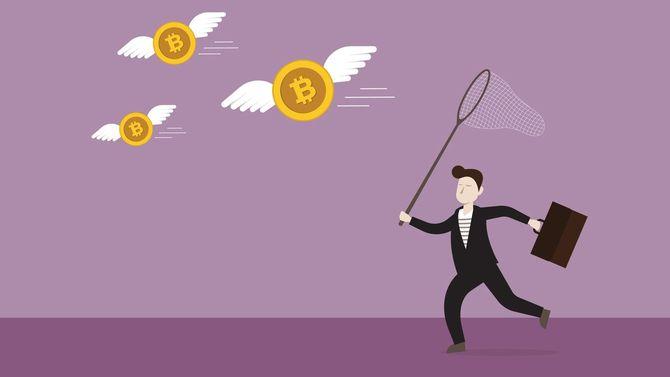 虫網を用いてビットコインをキャッチしようとしているビジネスマン