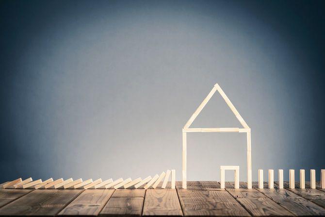 ドミノと住宅のイメージ