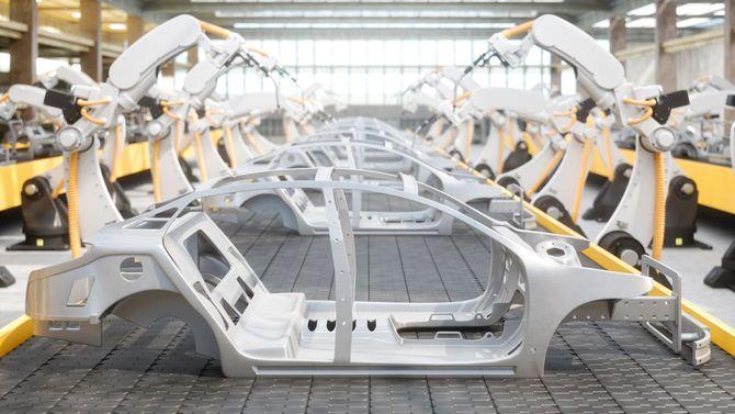自動車製造の自動化工場の組立ラインでの産業用溶接ロボット。