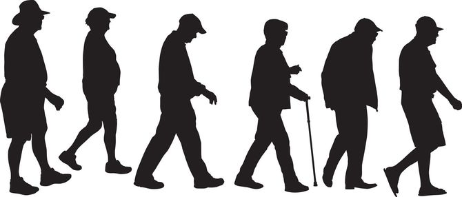 高齢者が歩くシルエット