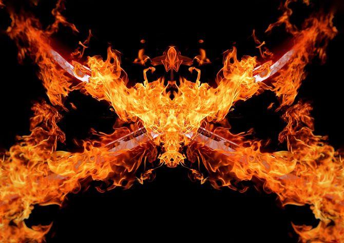 暗闇で交差する炎の剣のイラスト
