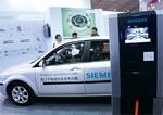 北京などでEV関連(充電スタンド)の展示会が開かれている。(AFLO=写真)