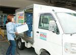 宅配事業を始めた当初は配送を業者に委託していた。自社で行っているいまは小回りが利く軽トラックを100台ほど所有する。