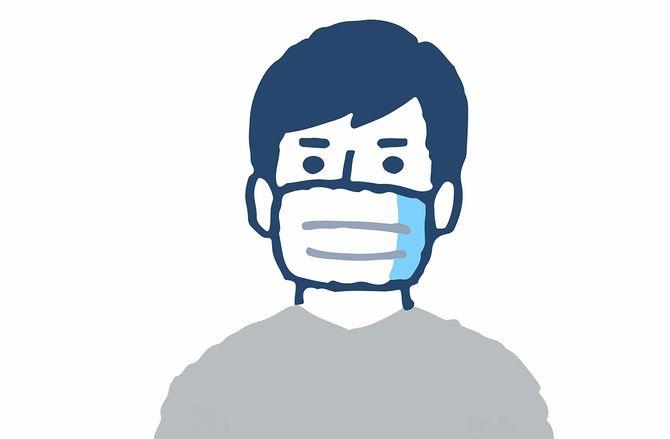 仮面をかぶる一人の若者