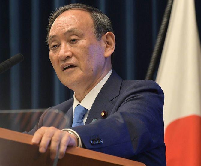 記者会見する菅義偉首相